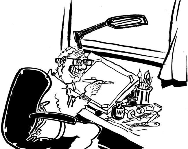 caricaturist or cartoonist Simon Ellinas at drawing board